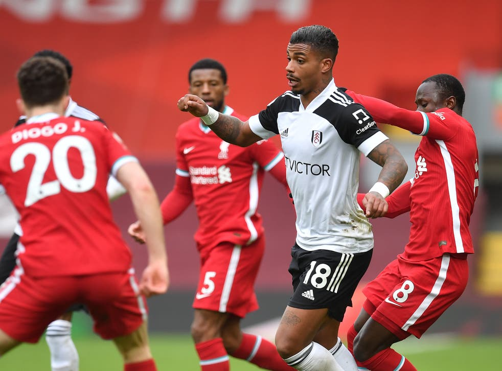 Fulham goalscorer Mario Lemina is surrounded by Liverpool players