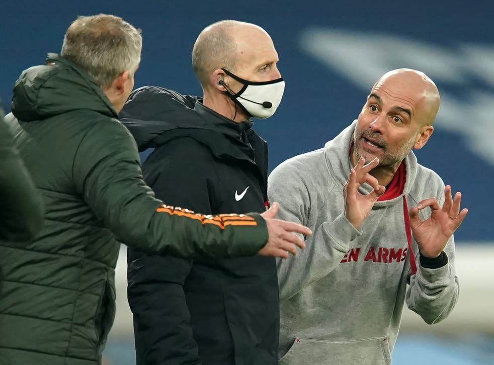 <p>Pep Guardiola speaks to Ole Gunnar Solskjaer on the touchline</p>