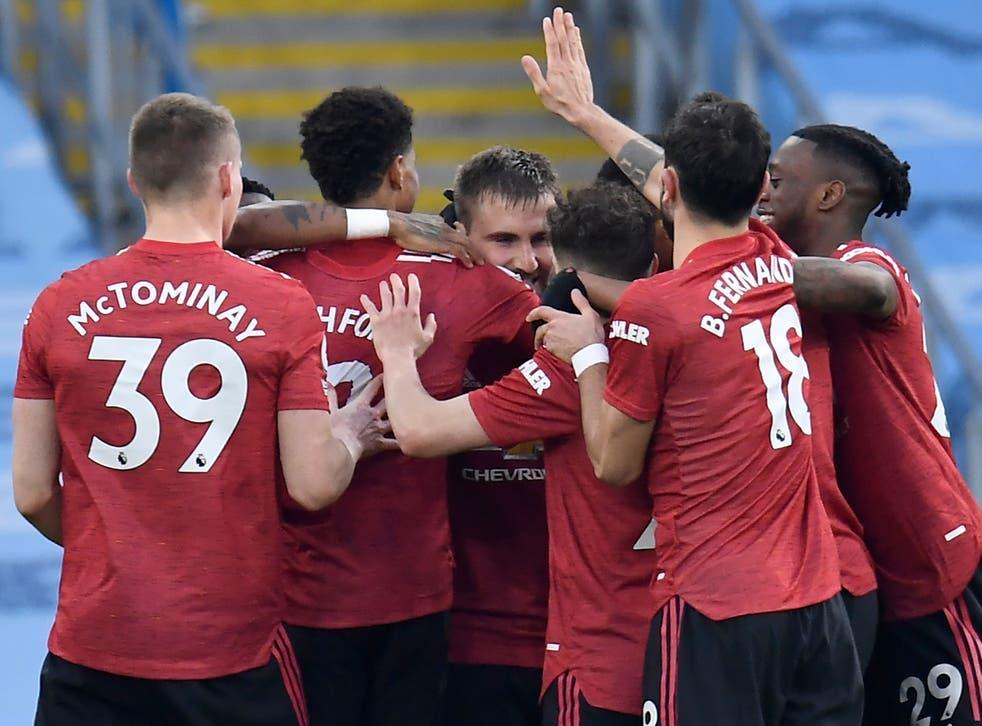 <p>Manchester United celebrate Luke Shaw's goal</p>