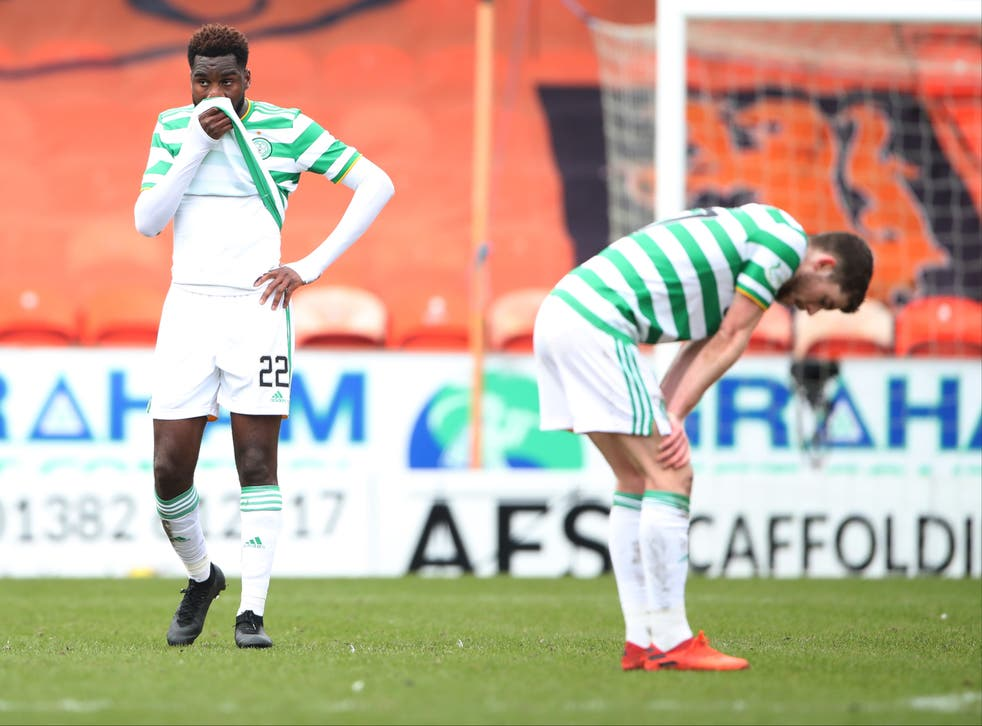 Celtic players react after drawing at Dundee United
