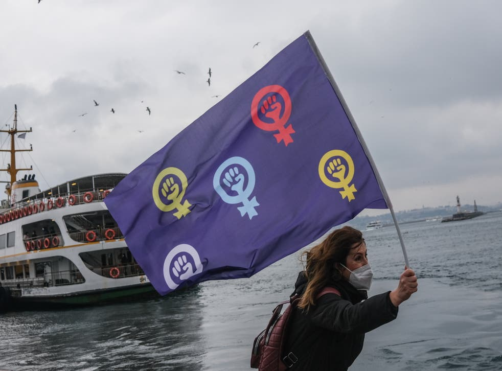 female protestor hold feminist flag and shout slogans during demonstration on the occasion of the International Day for the Elimination of Violence Against Women in Istanbul at the weekend