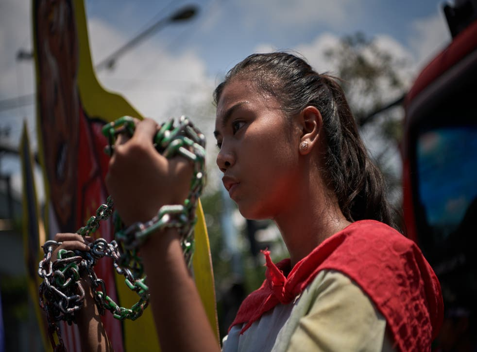 <p>Protesters march to mark International Women's Day in Manila in the Philippines</p>