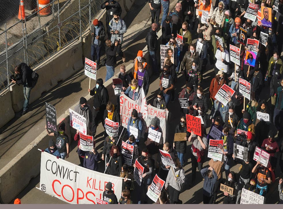 <p>Hundreds of demonstrators march through Minneapolis following protests near the Hennepin County Government Center on 8 March 2021, in Minneapolis where the trial for former Minneapolis police officer Derek Chauvin began with jury selection. </p>