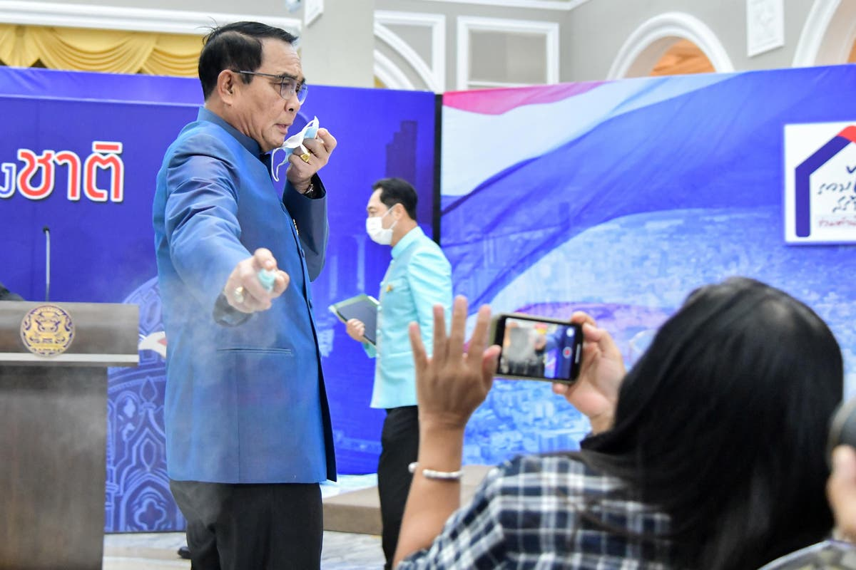 Thai PM sprays journalists with hand sanitiser as they try to grill him
