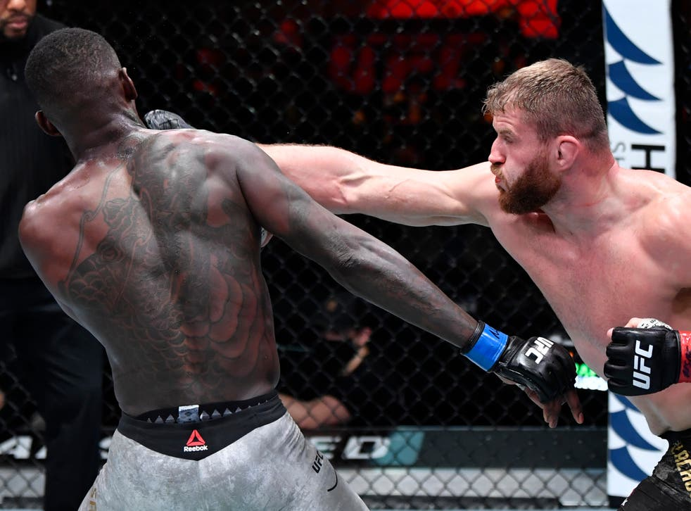 Jan Blachowicz (right) retained his light heavyweight title against middleweight champion Israel Adesanya