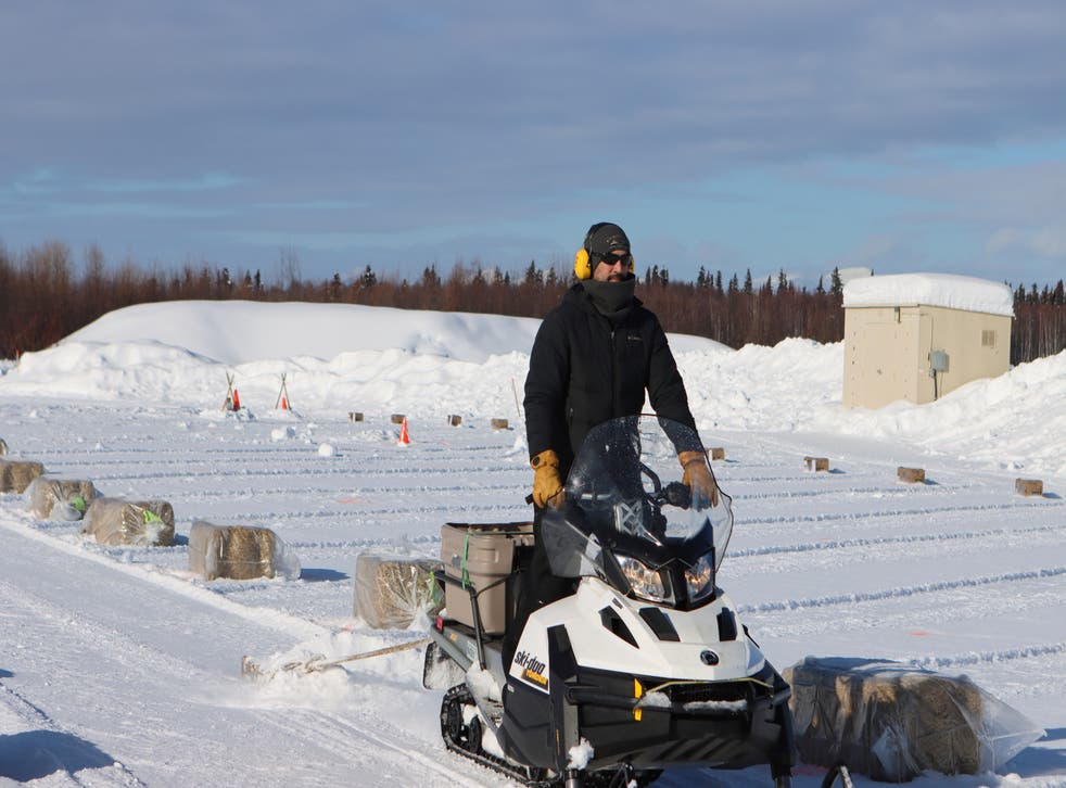 <p>A snow machiner drags a pallet to smooth out snow lanes in the new dog lot which has been set up at the McGrath checkpoint to accommodate COVID-19 precautions during the Iditarod Sled Dog Race on Tuesday March 9, 2021, in Alaska</p>