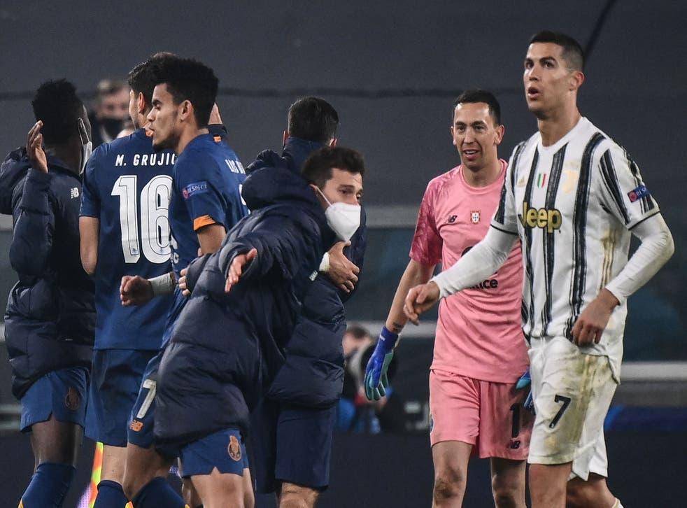 <p>Cristiano Ronaldo looks on as Porto celebrate</p>