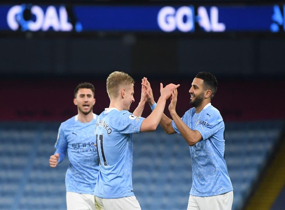 Riyad Mahrez celebrates after scoring City's fourth goal