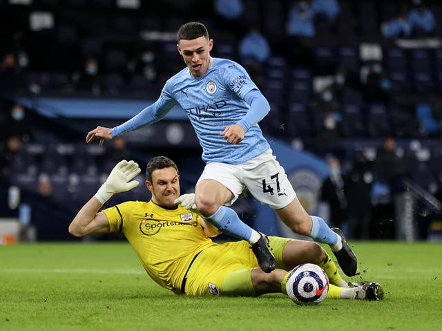 Manchester City forward Phil Foden and Southampton goalkeeper Alex McCarthy