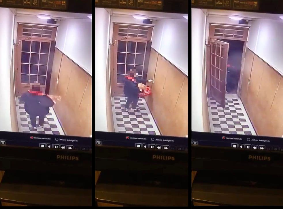 <p>The Just Eat deliverer was captured on CCTV in a building in Paris carrying a cat on 9 March, 2021</p>