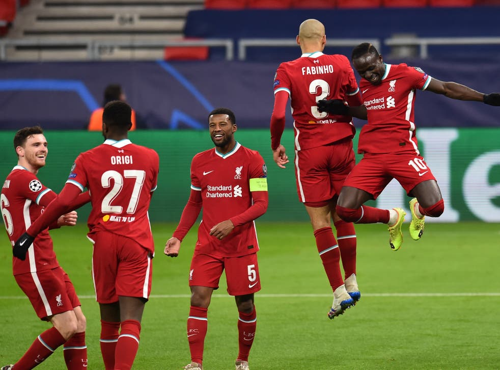 Liverpool players celebrate Sadio Mane's (right) goal