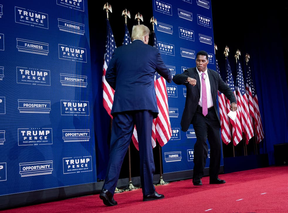 <p>US President Donald Trump is greeted by NFL hall of fame member Herschel Walker during an event for black supporters at the Cobb Galleria Centre September 25, 2020, in Atlanta, Georgia</p>