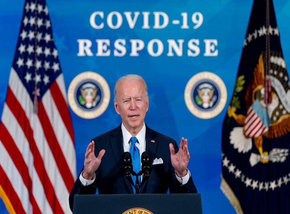 Virus Outbreak One Year Biden
