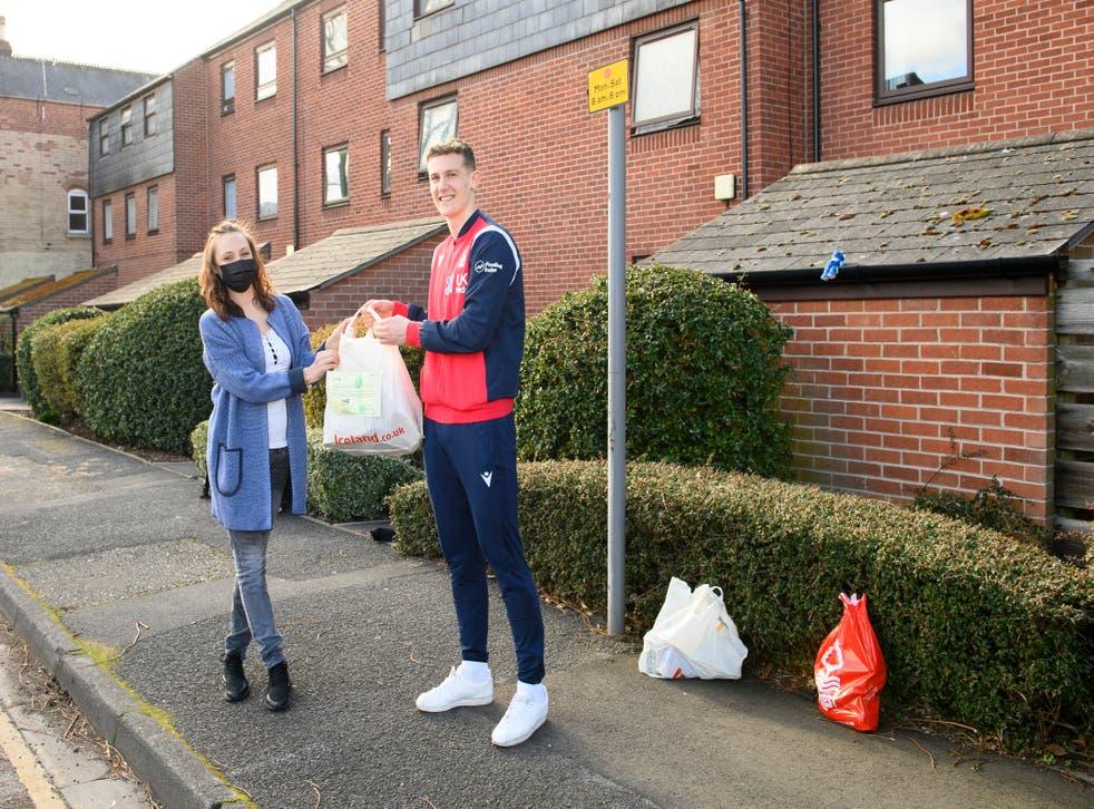 Ryan Yates of Nottingham Forest delivered the one millionth EFL food parcel to Sandie Gee – Husbands