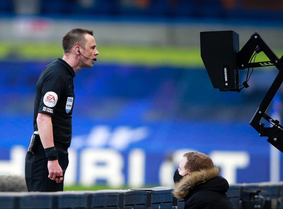 Referee Stuart Attwell checks the pitchside VAR screen
