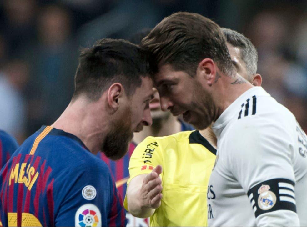 Lionel Messi and Sergio Ramos square up during El Clasico
