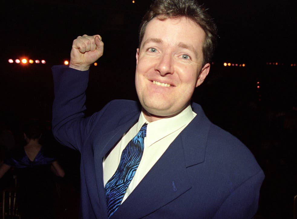 <p>One-man outrage: Piers Morgan takes aim while attending the 1994 Brit Awards</p>
