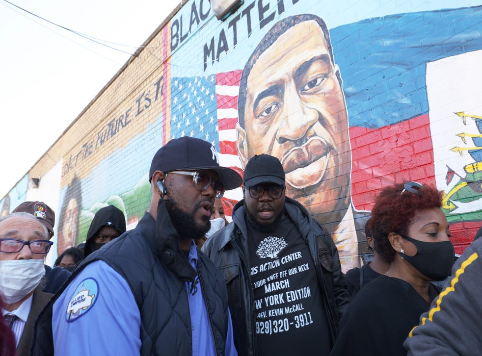 <p>Terrence Floyd (left) marches during a vigil in celebration of his brother George's 47th birthday </p>