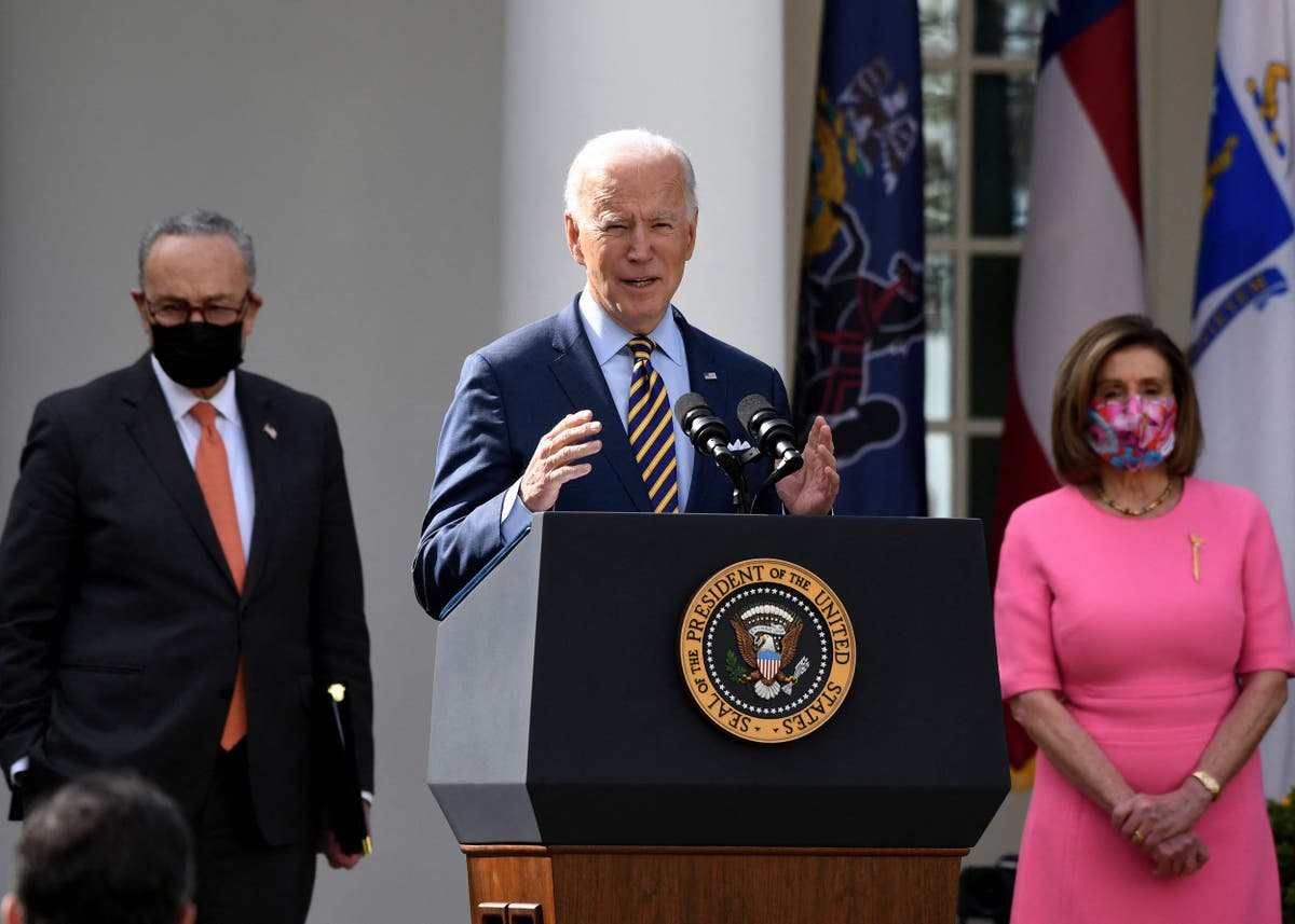 Biden condemns 'trickle-down' economics as Democrats celebrate passage of historic relief legislation