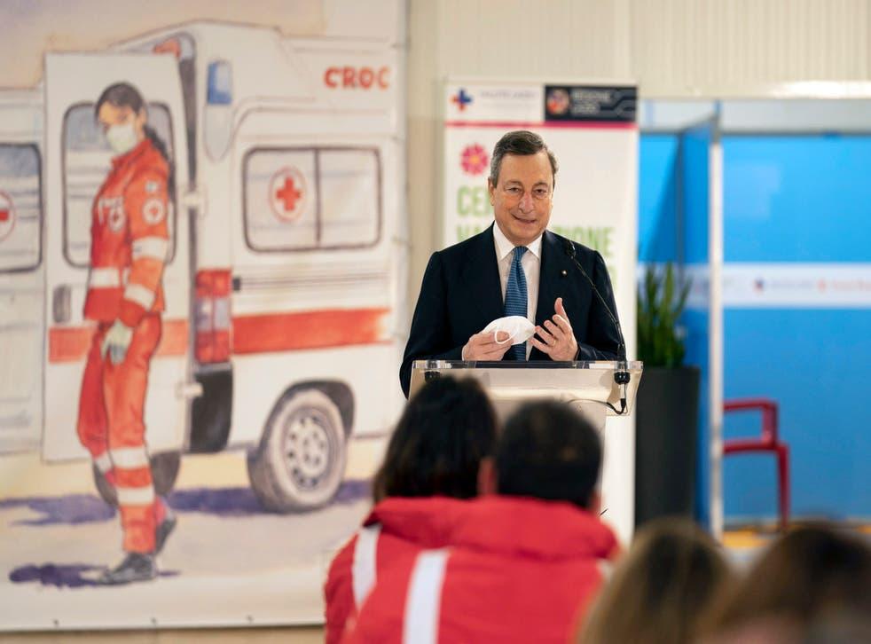 <p>Italian prime minister Mario Draghi delivers a speech in front of medical staff at the vaccine centre of Leonardo da Vinci airport in Fiumicino, near Rome</p>
