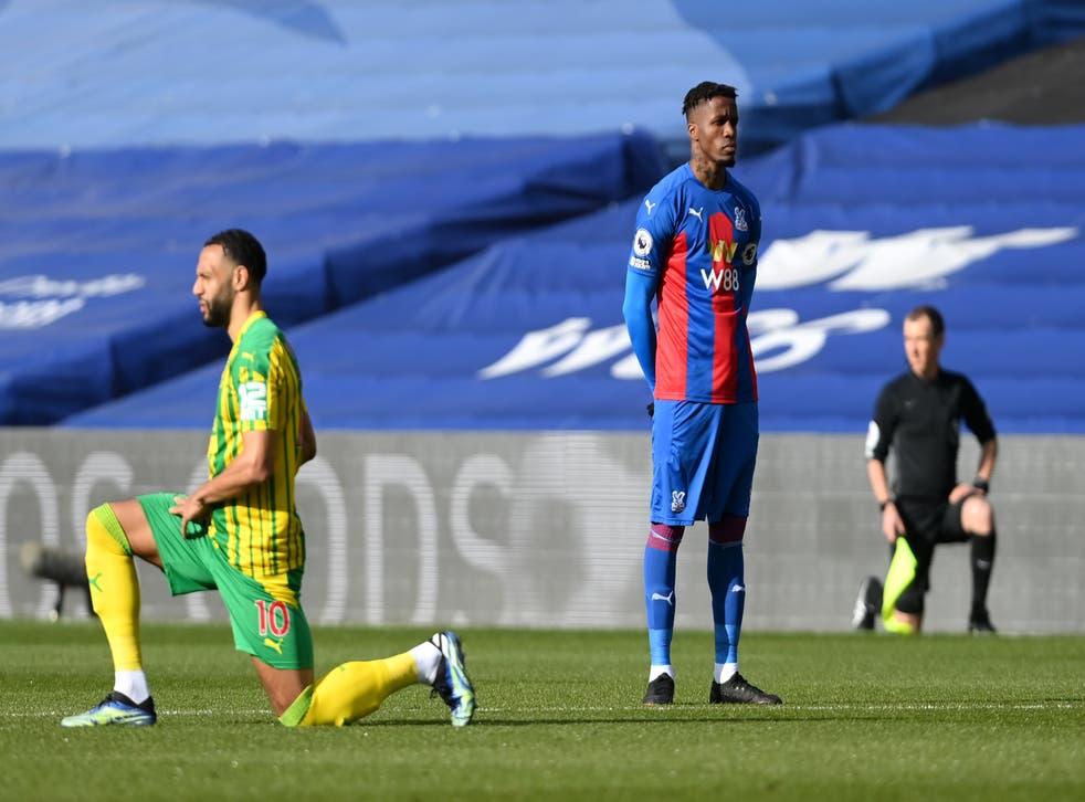 <p>Wilfried Zaha of Crystal Palace stands at kick off </p>