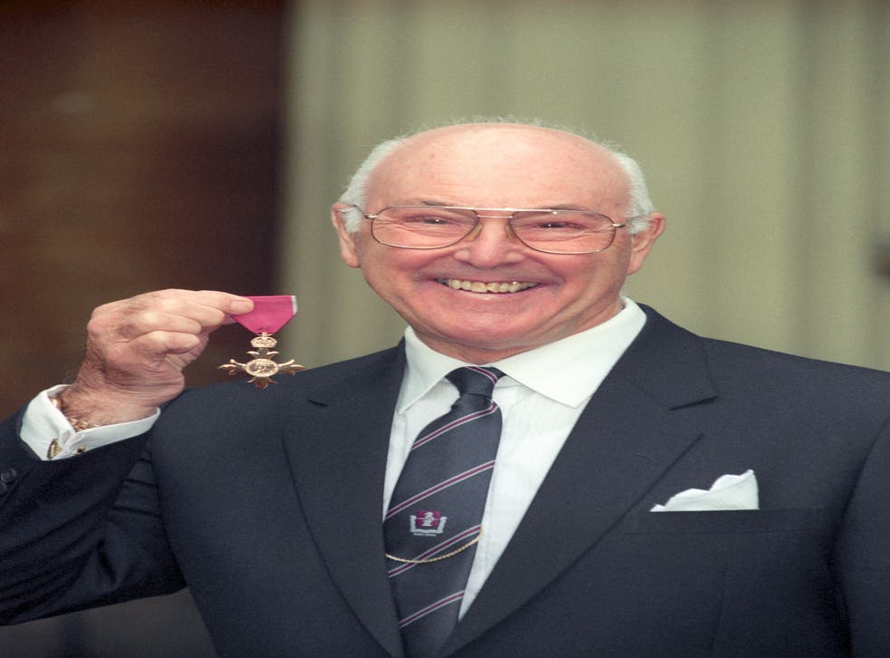 <p>Murray Walker with his OBE in 1996</p>