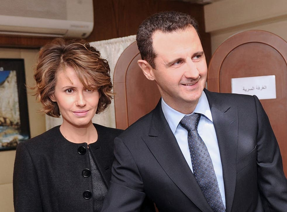 Syrian President Bashar al-Assad and his wife Asma in Damascus in 2012