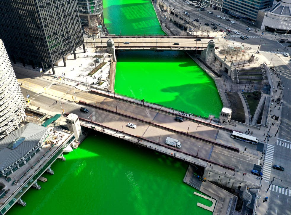 <p>The Chicago River flows through downtown after it was dyed green in celebration of St Patrick's Day on 13 March, 2021 in Chicago, Illinois</p>