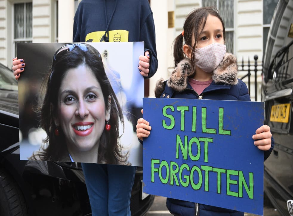 <p>Gabriella Zaghari-Ratcliffe stands with her father, Richard, in a protest outside the Iranian embassy in London</p>