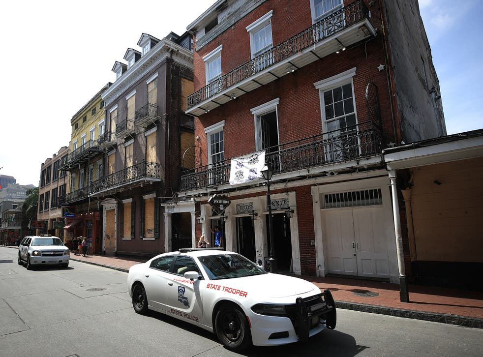 A State Trooper vehicle drives down Bourbon Street in the French Quarter on March 15, 2020 in New Orleans, Louisiana.