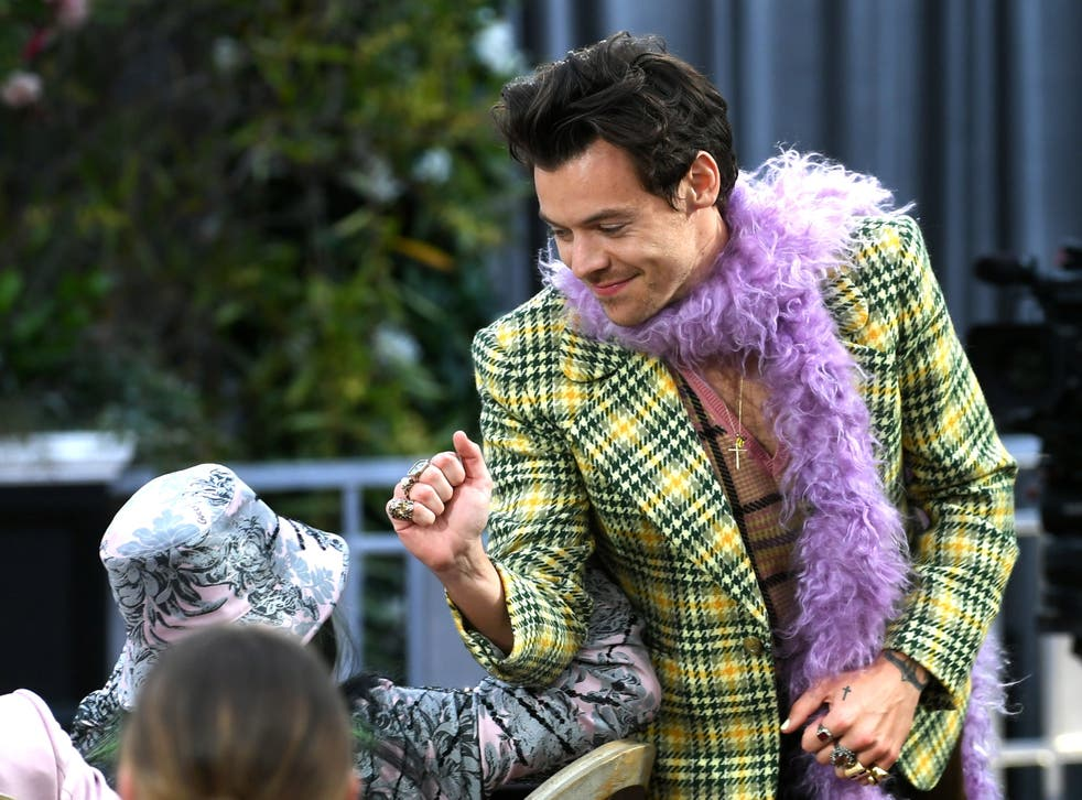 <p>Harry Styles greets Billie Eilish at the 2021 Grammys</p>
