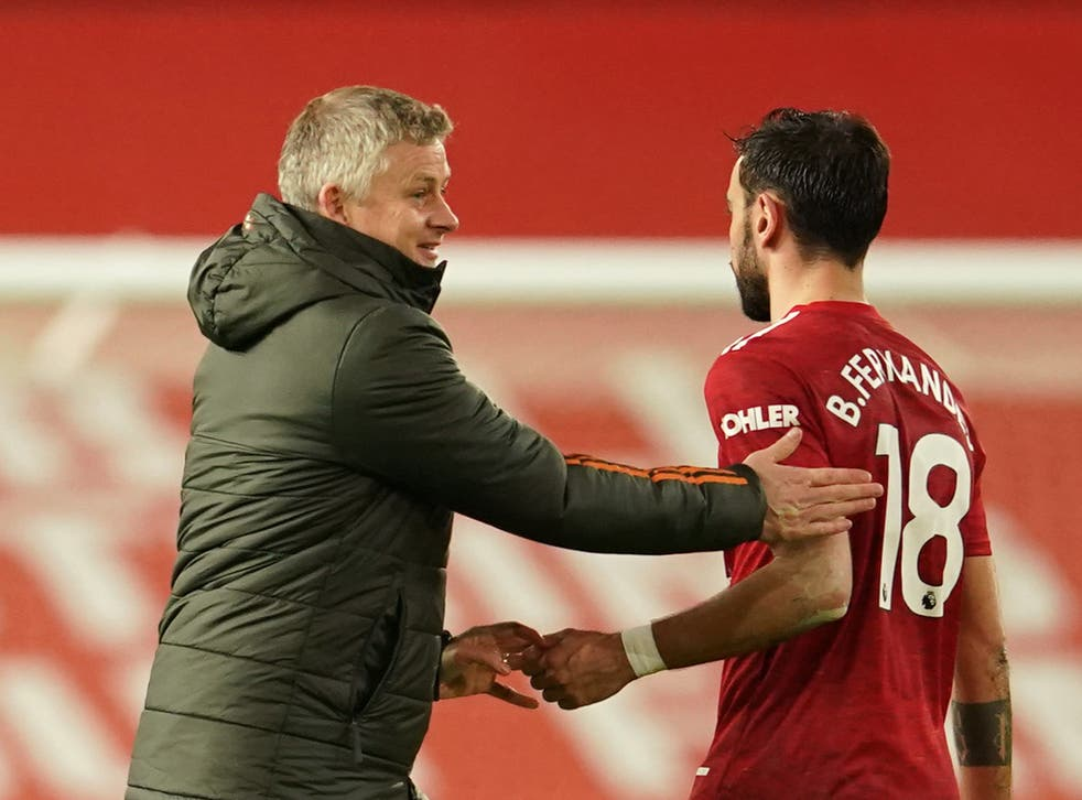 Man United coach Ole Gunnar Solskjaer with midfielder Bruno Ferandes