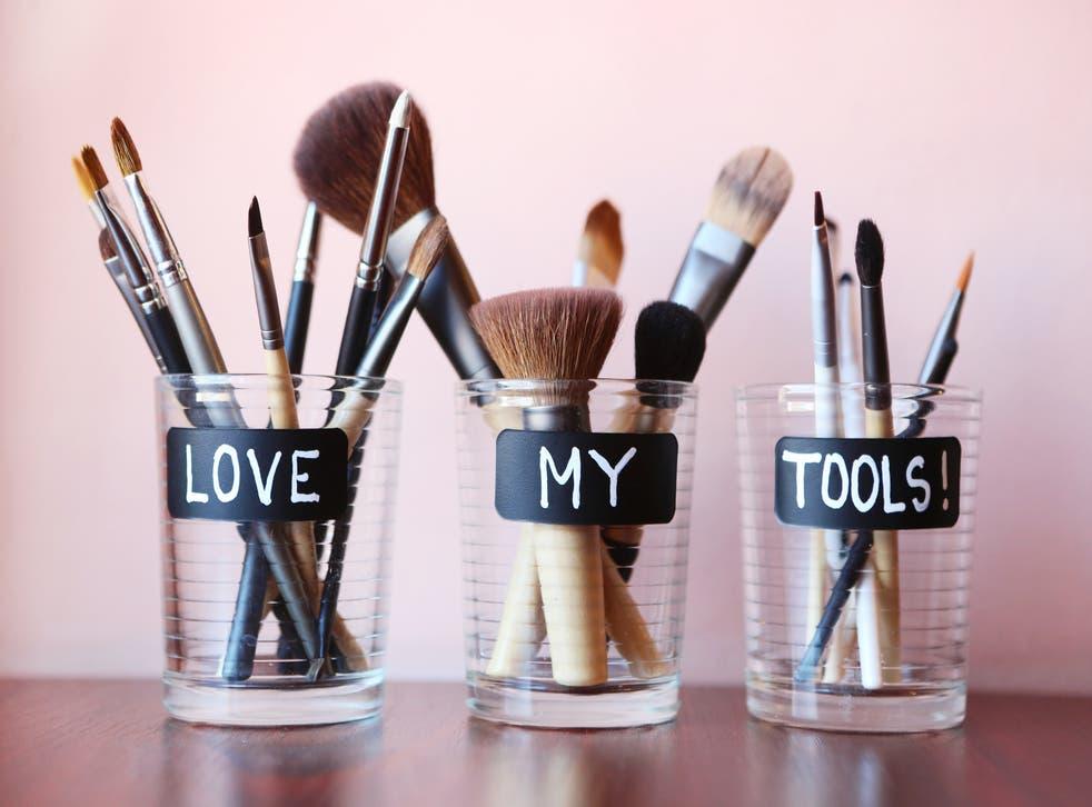 make-up brushes in jars