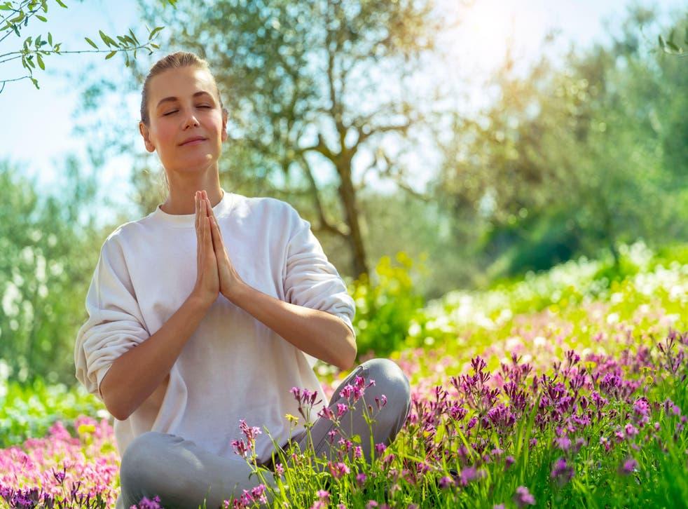Woman doing yoga (Alamy/PA)