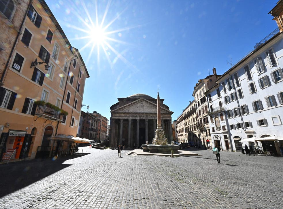 People walk on the Piazza della Rotonda square in front of the Pantheon monument in central Rome as three-quarters of Italians entered a strict lockdown