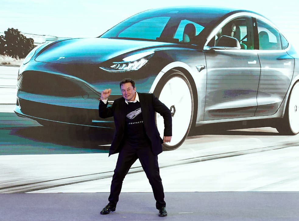 Tesla CEO Elon Musk dances onstage during a delivery event for Tesla China-made Model 3 cars in Shanghai, China 7 January, 2020