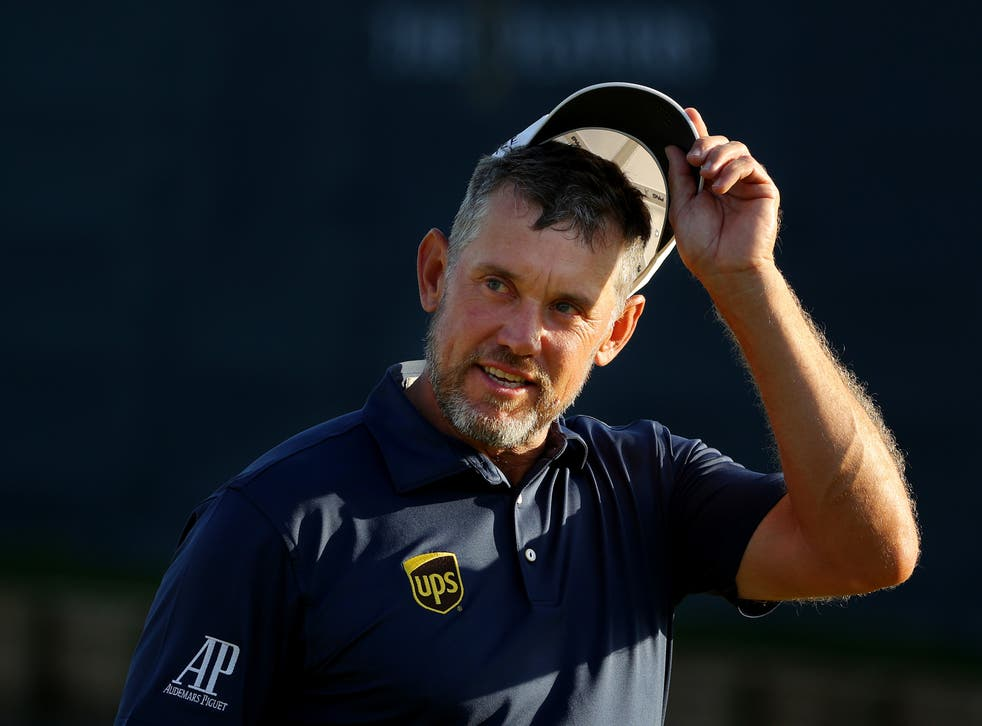 Lee Westwood tips his at on the 18th green at TPC Sawgrass