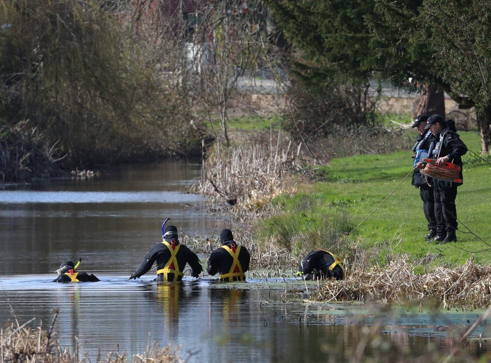 <p>Police divers search near Rope Walk in Sandwich, Kent, as inquiries into the death of Sarah Everard continue</p>