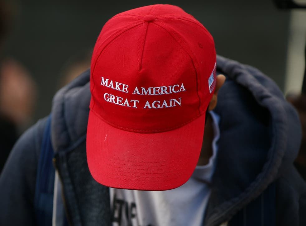 <p>The bright red hats were created by Donald Trump for his presidential run (File photo)</p>