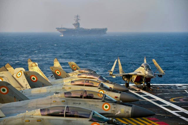 Indian army fighter jets on the deck of an aircraft carrier during an exercise last November