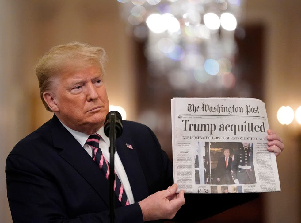 <p>US President Donald Trump holds a copy of The Washington Post as he speaks in the East Room of the White House one day after the US Senate acquitted on two articles of impeachment, ion February 6, 2020 in Washington, DC</p>