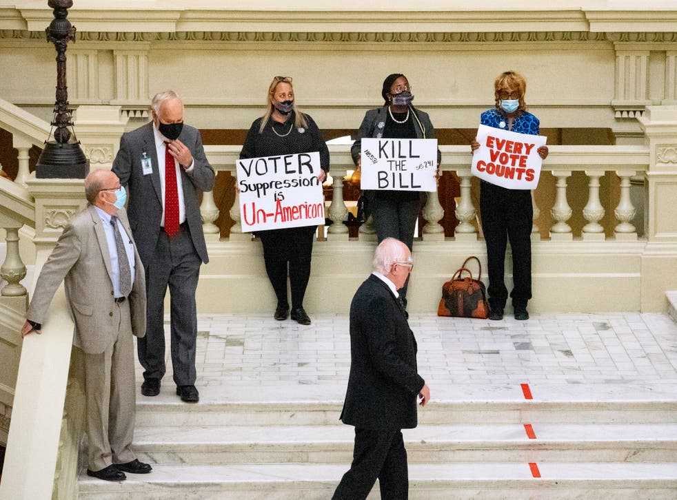<p>Demonstrators protest inside Capitol building to oppose HB 531 on 8 March, 2021 in Atlanta</p>