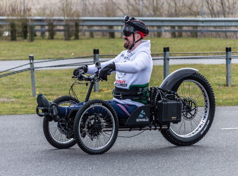 Martin Hibbert, 44, riding in a custom-built handbike
