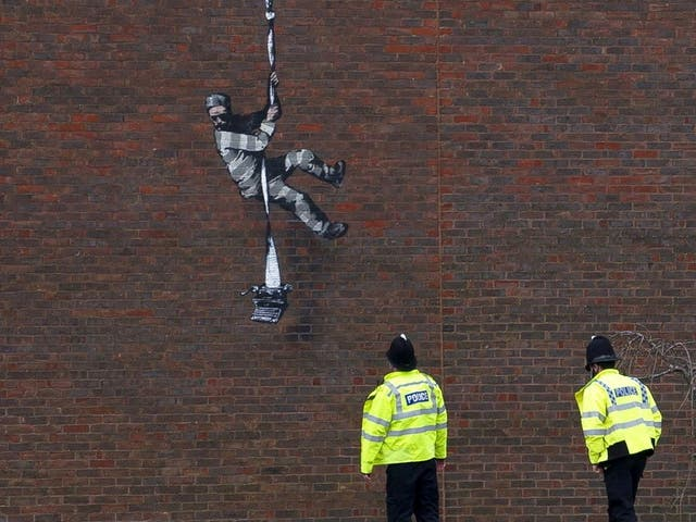 <p>File Image: Mural of artist Banksy on a wall at HM Reading Prison</p>