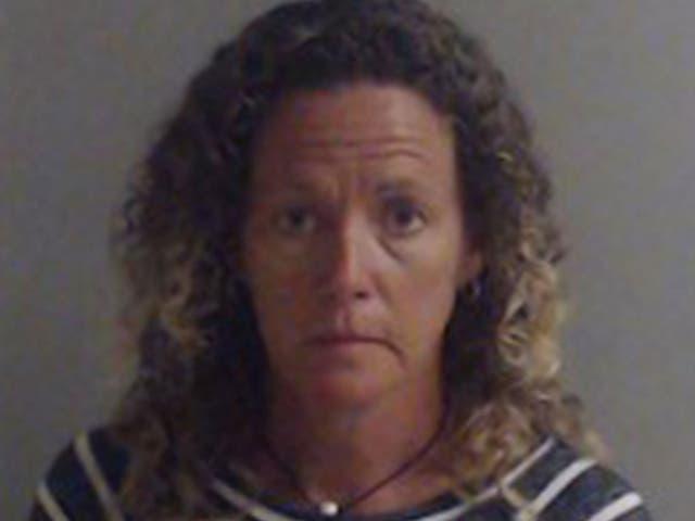 <p>Laura Rose Carroll in police custody</p>