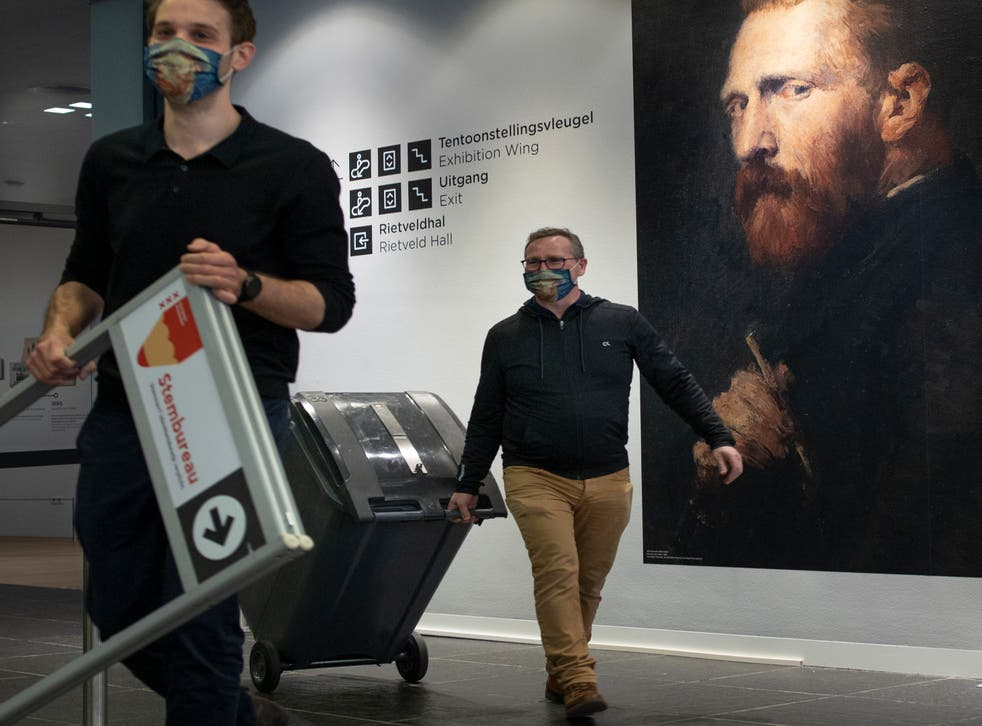 <p>A ballot box is brought to a polling station inside the Van Gogh museum in Amsterdam</p>