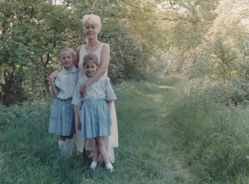 Flack pictured alongside her twin sister Jody and mother Christine