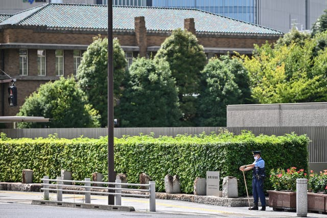<p>File: A policeman patrols on a road leading to the residence (background) and office of Japan's Prime Minister in Tokyo</p>