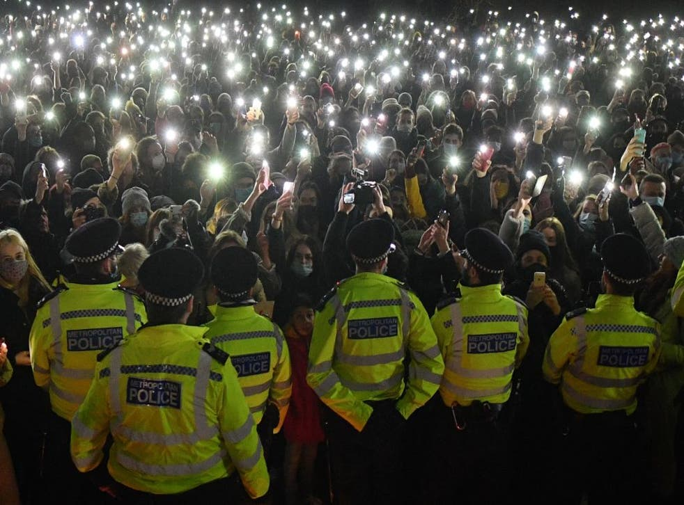 <p>Police officers form a cordon at vigil for alleged murder victim Sarah Everard on 13 March.</p>