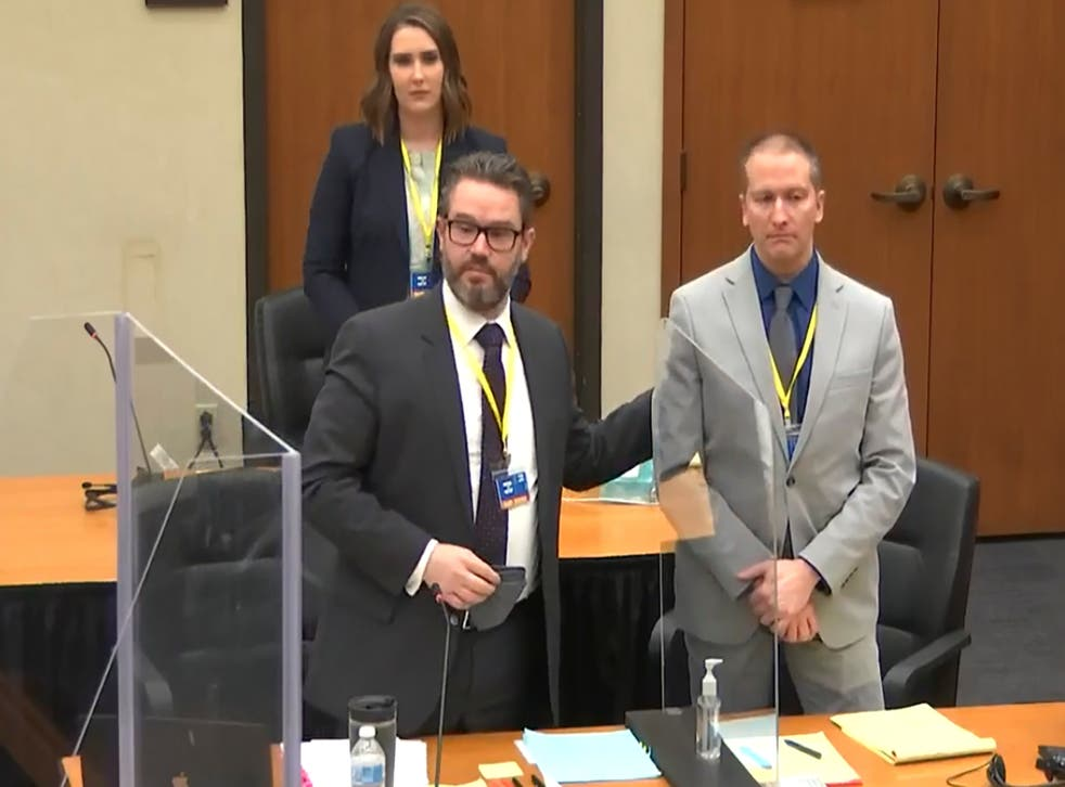 <p>In this screen grab from video, defense attorney Eric Nelson, left, defendant and former Minneapolis police officer Derek Chauvin, right, and Nelson's assistant Amy Voss, back, introduce themselves to jurors as Hennepin County Judge PeterCahill presides over jury selection in the trial of Chauvin Wednesday, March 17, 2021 at the Hennepin County Courthouse in Minneapolis, Minn.  Chauvin is charged in the May 25, 2020 death of George Floyd.  </p>